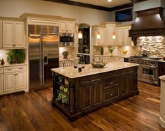 Modern Luxury KItchen Design With Island and Wood Flooring