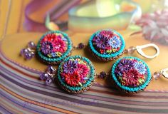 These earrings just took my breath away! they are by jennifermorrisbeads on Etsy.