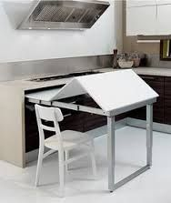 pull-out table which folds completely away inside a cabinet
