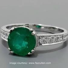 Esmerald and diamond ring