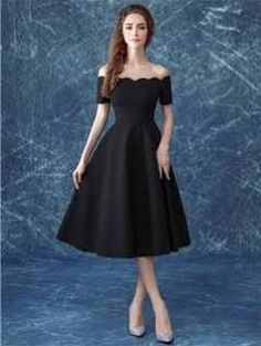 tea length black dress with sleeves
