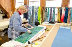 Penland student Diane Kirschenbaum rolling dye/reduction material onto a foam stencil in preparation for making patterned silk scarf through the vat-dye discharge process. (photo: Robin Dreyer)