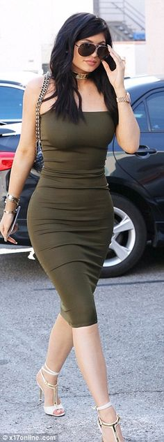 Kim Kardashian and Kylie Jenner don similar body hugging green dresses #dailymail Kylie Jenner Style, Kendall Jenner Body, Big Challenge, Best Beauty Tips, Thigh, Challenges, Jigsaw Puzzles, Lace Up, Eye Makeup