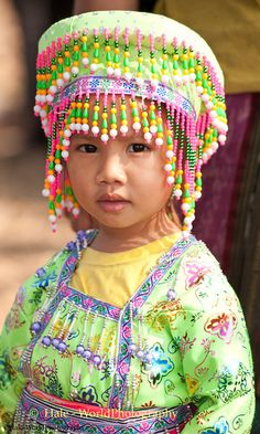 Young Hmong Girl in Traditional Clothing at New Year's Festival in Luang Prabang, Lao People's Democratic Republic. By Hale WorldPhotography