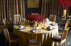 The table is set for a holiday dinner with plates Aerin Lauder inherited from her grandmother, Estée, and branches in vases from her Aerin line.