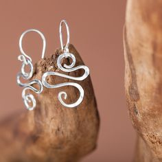 Beauty and whimsy! I love them. The ethereal design almost looks like it was forged in a dream.