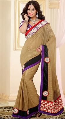 Look ethnic in this beige jacquard party wear saree. The lovely dangler, patch, resham, stones & unique border work a substantial feature of this attire.  #DesignerSaree