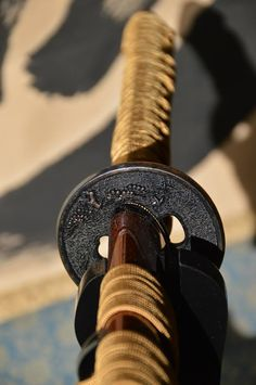 Practice blade handle. Roman with its colors--pewter and tan and brown. But still has the feel of a scim.
