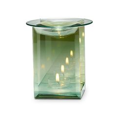 "Infinite Reflections Fragrance Warmer - Reflective surfaces on front and back panels create multiple points of light from burning tealight, sold separately. Glass dish holds Scent Plus® Melts, or Scented Oil sold separately. 5"" h, 4"" w.  Only $32 each!"