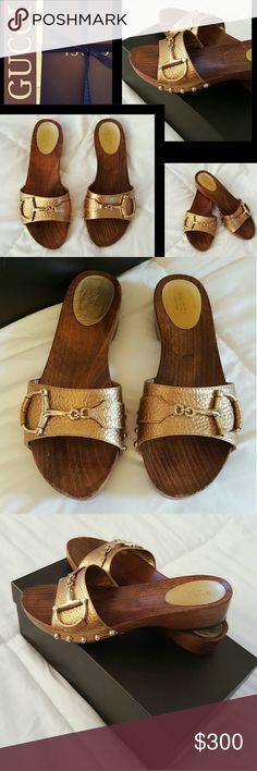 """Gorgeous Authentic Gucci Horsebit Slide Sandals 7 EUC WORN ONCE STUNNING! Authentic Gucci horsebit slide sandals Sz 7. They are comfortable for everyday wear yet classy & dressy for a summer party. Just slip them on & go. The color is a rich bronze/golden color with the dark wooden platform. 1"""" front platform, 1.25"""" back heel. Black perfectly intact rubber soles with no sign of wear in the heel as for being worn down. There are a couple scratches on the wood but not noticeable. They are…"""