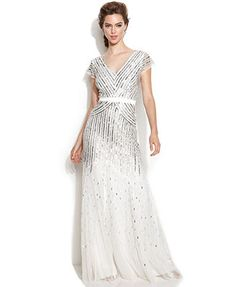 This also comes in black and silver.  $250 with free shipping and free store returns right now...  Macy's  Adrianna Papell Cap-Sleeve Sequined Gown