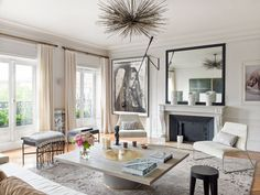 I love Paris apartments. I love art. Put the two together and designed by the insanely talented Emma Donnersberg and you have an uber-chic pad that I want to hang out in forever.
