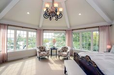 This is the master bedroom of your dreams. Sky-high vaulted ceiling, huge windows with a view, and tons of room.