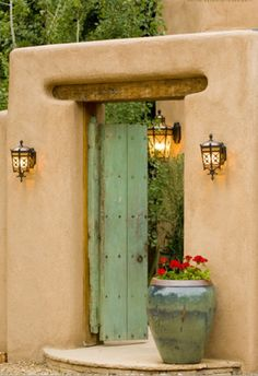 Santa Fe green gate! Love the way an old door painted makes such a huge difference and looks stunning against the stucco ochre wall. I love old and vintage stuff modernized