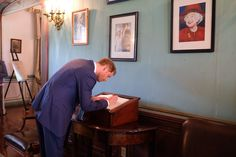 """Kensington Palace on Twitter: """"Under the gaze of photographs of The Queen, Prince Harry signs the guestbook at Government House in Antigua #RoyalVisitAntiguaBarbuda"""