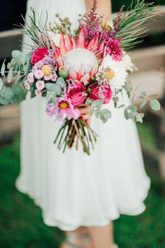 Protea centered bridal bouquet perfect for a spring wedding | Image by Madeline Kate Photography