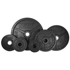 Troy High Grade Fully Machined Wide Flanged Olympic Plate. Rich baked black enamel. Designed for all 2 in bars. ASTM Grade 20 cast iron. High Grade machined plates.