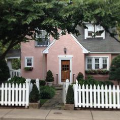Morning walk! How cute is this pink cottage ? Via: glitterguide
