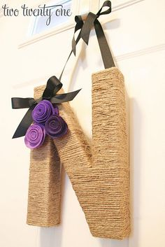 Perfect fall wreath for the front door! Use a paper mache letter from HobLob and cover in jute twine. Look at the site for instructions!