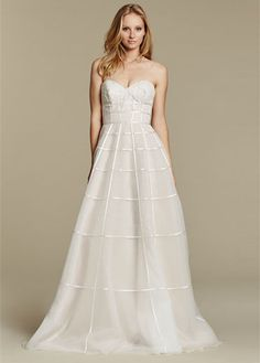 """""""Easton"""" gown. Ivory over cashmere tulle A-line bridal gown, ivory ribbon crosshatch detail, strapless sweetheart neckline with layered lace appliqué."""