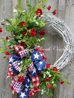 Patriotic Wreath, Summer Cottage Wreath, 4th of July Wreath, Memorial Day Wreath, Summer Floral Wreath, Garden Wreath, Designer Wreath Martha's Vineyard Cottage Wreath. A lovely collection of delicate red and white blossoms mingle with lush greenery on a whitewashed rustic grapevine frame. A posh triple layer bow fashioned from check and star prints adds a quaint and festive touch to this summertime patriotic classic. ~New England Wreath Company Designer Original~ Realistic, high-quality…