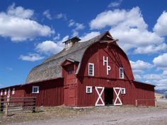 red barns, blue sky...love this barn!