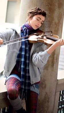 Playing violin by the window. I hate violinist stereotypes, and you all know the ones I mean. The worst one is that it is boring. I especially love how her outfit is cute, but not fancy.