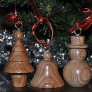 Set of three hand turned Christmas decorations for the tree includes -  Snowman  Bell           Mini Tree           Wood used is ash.