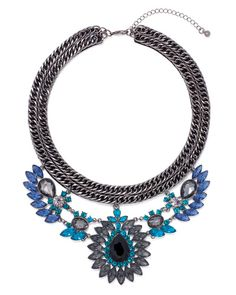 A dramatic necklace is irresistably glam. About the Necklace: Hematite with blue and clear crystals. Total neckdrop is 5 with an 8.5 pendant drop and 3.5 extender chain. Lobster claw closure.*
