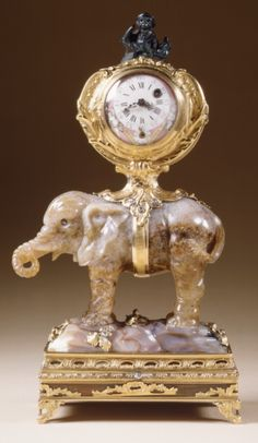 Miniature clock in the form of an elephant supporting a watch case. ca 1750; watch dial a later 18th century replacement Agate, heliotrope, gold and diamonds