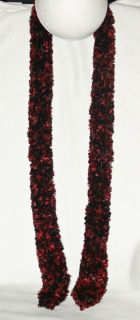 Blend of Red and Black eyelash yarn hand loomed.  Wear as a scarf or add a brooch for an infinity scarf look.  59 in. long