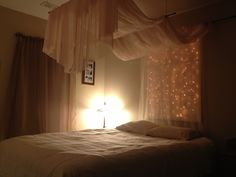 Canopy with lights. Something like this might be good to disguise the slanted wall behind my bed.
