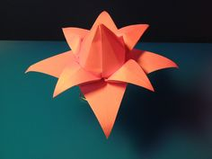 Fiore ad otto petali curvi (seconda versione) - Flower with eight petals curved (second version).  Origami from one uncut square. Designed and folded by Francesco Guarnieri, August 2008.