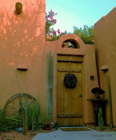 Classic wooden door and Southwest decor. I love the quality of light in New Mexico. If I cannot have an old Victorian home, I would chose an old adobe with simple, soft curves and lines in this earthy tone.