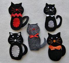 felt cats :-)  Idea for my daughter...