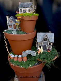 Stack pots to create a verticle fairy garden. #miniaturefairygardens