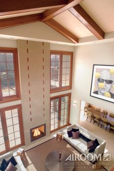 Hand-carved teakwood beams and a thatched texture lend a decorative element to a cathedral ceiling in a Highland Park, Illinois great room.