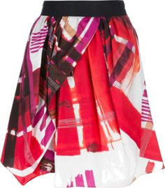 Pink and purple cotton skirt featuring a multi-color abstract print, an asymmetric hem and an A line shape.