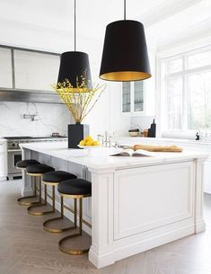 "Black and white kitchens, sometimes termed ""tuxedo kitchens"" are absolutely beautiful when done right. Here's how to pull off a black and white kitchen like a pro. #kitchendesign #kitchendecor #blackandwhitekitchen #homedecor #interiordesign #decor #kitcheninspiration #tuxedokitchen"