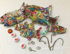 Working on some Small Fish today. Grateful to all my friends who have saved Pull Tabs and Bottle Caps for me! Small Fish, Old Magazines, Colorful Fish, Salvaged Wood, Assemblage Art, Bottle Caps, Environmental Art, Fish Art, Recycled Art