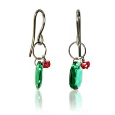 Libertad, Eugenia by Tous  LIBERTAD earrings in burnishedsterling silver, smoky quartz, tsavorite and green and red hydrothermal gems. / Pendientes LIBERTAD en plata ...