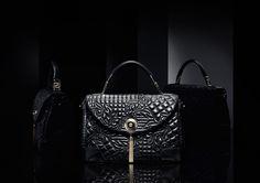 "Altea ""Vanitas"", a classic quilted top handle bag with flap opening and snap fastening. #Versace #VersaceVanitasBag"