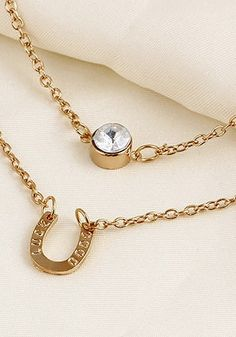 4b874335c6d91 Accessories    This gold horseshoe crystal layered necklace is designed  with two layers of gold