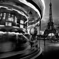 Grey Grey Grey! spinning on the carousel with tower in the background.
