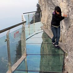 Tianmen Mountain in is a very popular tourist attraction because of the Glass sky walk, located 4,690 feet above the sea level on the side of the Tianmen Mountain in Zhangjiajie province of China. Walking on this see-through glass is a terrifying and thrilling experience, but definitely not for the faint hearted. If you are afraid of the heights, just don't look down while walking on that Glass. http://www.lonelyplanet.com/china/hunan