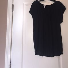 Never worn tie front black top with elastic waist. Never worn tie front black rayon top with elastic waist. Tops
