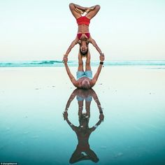 Honza and Claudine specialise in AcroVinyasa, a type of yoga that combines the traditional practice with L-based acrobatic flying Couples Yoga Poses, Acro Yoga Poses, Partner Yoga Poses, Fit Couples, Couple Yoga, 2 Person Stunts, Two Person Yoga Poses, Yoga Dance, Beach Yoga