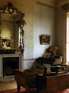 This is a very old room. Small piano and look at all those old books. Everything in their looks to be antiques. a small & cozy room with a fireplace. a grand piano, & books. Villa Interior, Interior And Exterior, Wabi Sabi, Beautiful Interiors, Beautiful Homes, French Interiors, Vintage Interiors, House Interiors, Beautiful Things