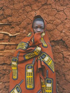 African cloth designs reflecting modern technology and could be applied to other things. Love the simple classical use of African color and pattern for unexpected object.