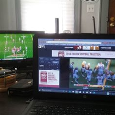 Watching Clemson on T.V. and Alabama on the computer.
